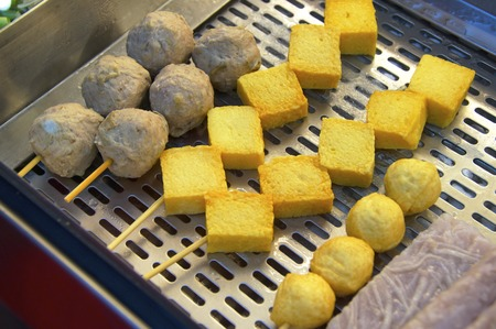 meat alternatives: Meat balls and tofu for sale in night market Stock Photo