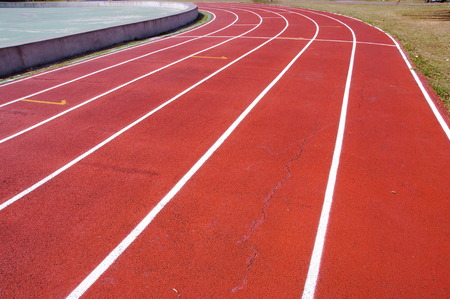 level playing field: An old running track with crack at school