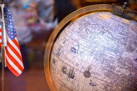 Stars and stripes and world globe through glass photo