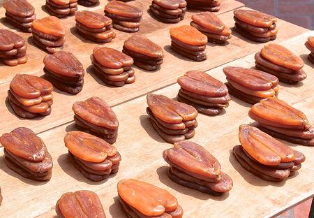 mullet: Mullet fish roe for sale at market