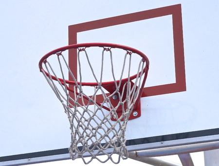 Basketball hoop and backboard at sports ground