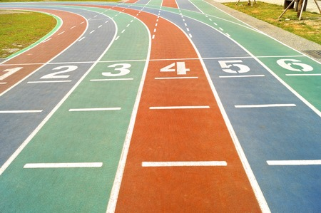 level playing field: Starting lines on colorful running track at playground