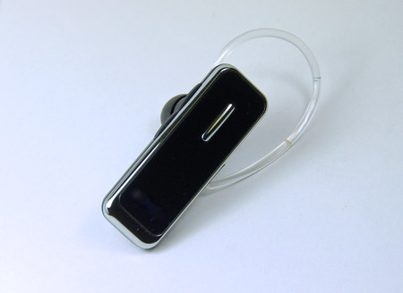 handsfree device: The bluetooth headset on a white background