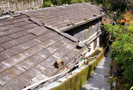 The slate roof of traditional house built by the aborigines photo