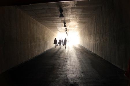 sleepwalking: People are walking through dark tunnel mean back to reality