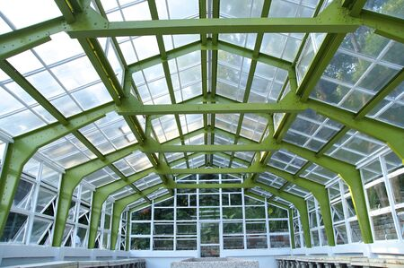 battle of the sexes: The closeup view of greenhouse framework at park