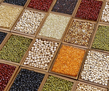 lima bean: Closeup of seeds and grains in wooden box