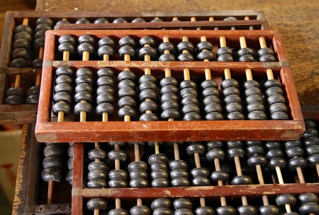 calculator chinese: The close view of Chinese abacus for calculation
