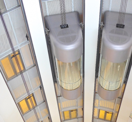 elevators: Exposed elevators shuttled in the department store Stock Photo