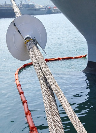 mooring: The closeup of marine rat guard on the mooring rope