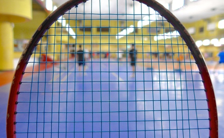 nylon string: Badminton racket with closeup at court