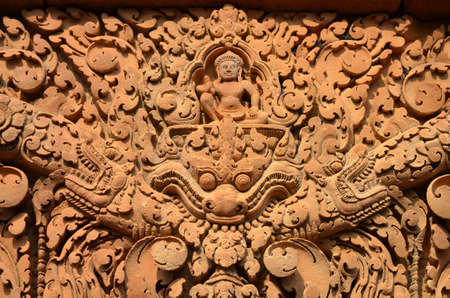 Detail of one of the multiple reliefs of the temple of Banteay Srei Angkor Cambodia photo