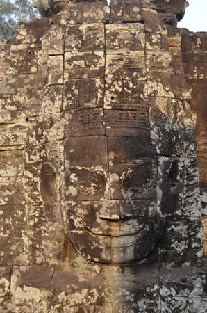 Face of Jayavarman VII in the temple of Angkor Thom Cambodia Bayn photo