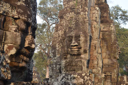 Profile and tower-shaped sculpted face in Bayon Angkor Thom Cambodia Stock Photo - 13625002