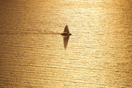 Sailboat at sunset on the island of Santorini Greece photo