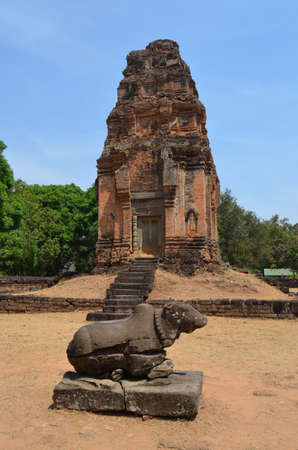 nandi: Nandi, The Sacred Bull in front of a brick tower in Preah Ko Temple Cambodia
