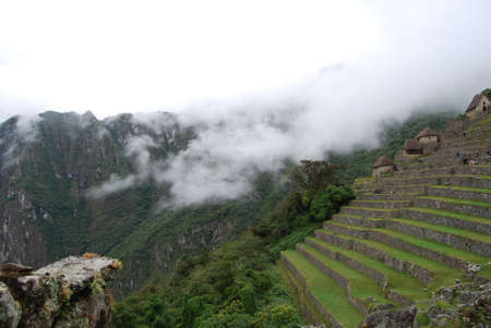 Traditional houses and terraces for growing Incas Machu Picchu in Peru photo