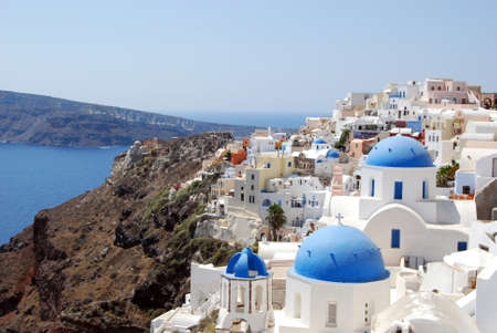 View of the town of Oia with its domes Santorini Greece photo