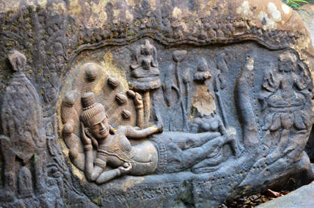 vishnu: Goddess Vishnu reclining on Kbal Spean Cambodia Stock Photo