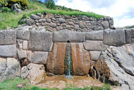 of homage: Tambomachay or Tampumachay is known for its canals and waterfalls that show the progress of the architects and hydraulic engineers Inca  Tambomachay was considered a center of worship and homage to water   Stock Photo