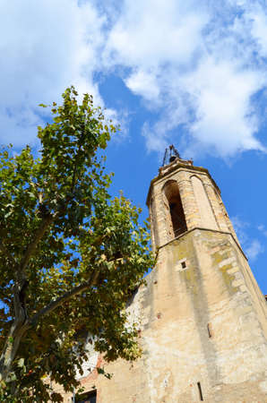 breda: Bell tower of the church of Breda Catalonia Stock Photo