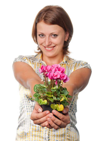 Smiling girl with cyclamens photo