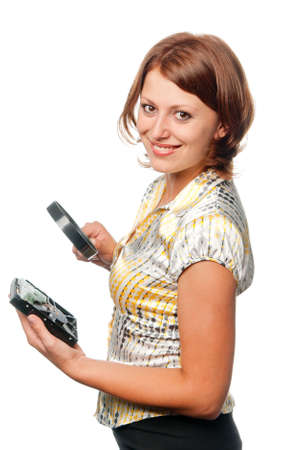 considers: Smiling girl considers hard driver through a magnifier Stock Photo