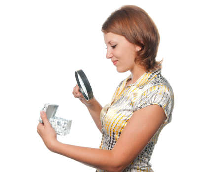 Girl looks at a gift through a magnifier photo