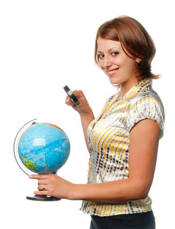 Smiling girl examines the globe through a magnifier photo