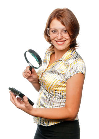 eyeshield: Smiling girl considers hard driver through a magnifier Stock Photo