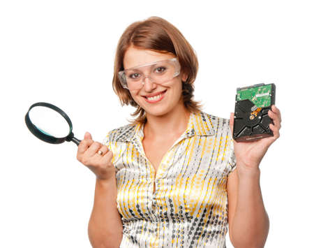 Smiling girl with  hard driver and  magnifier Stock Photo