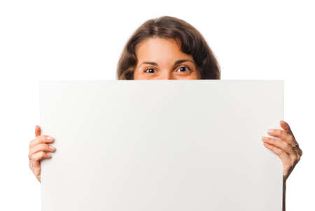 Pretty girl peeps out from behind the blank board Stock Photo - 7446821