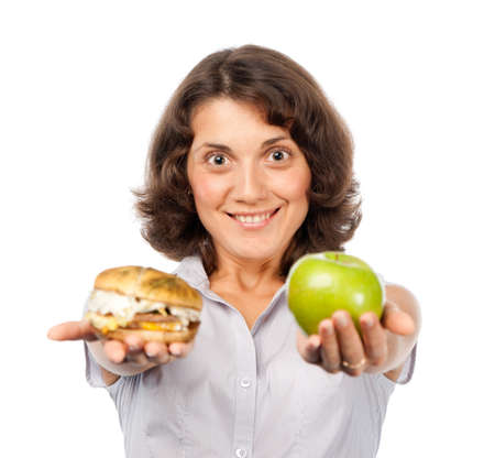 Pretty girl with a green apple and hamburger Stock Photo - 7461307