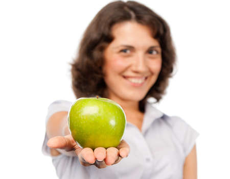 Pretty girl with a green apple photo
