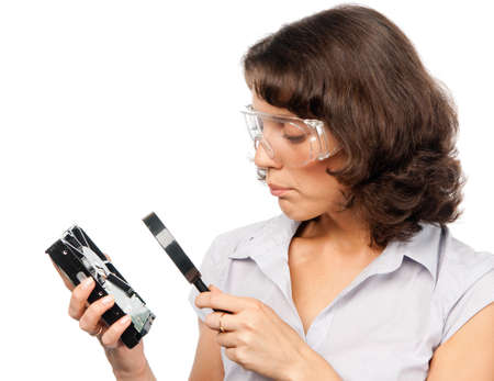 Pretty girl examines a hard drive Stock Photo - 7461369