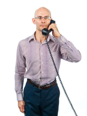 bespectacled man: Bespectacled man listens intently to phone
