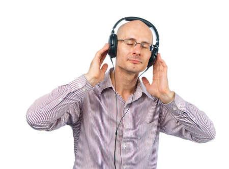 bespectacled man: Bespectacled man whith headphones enjoys music