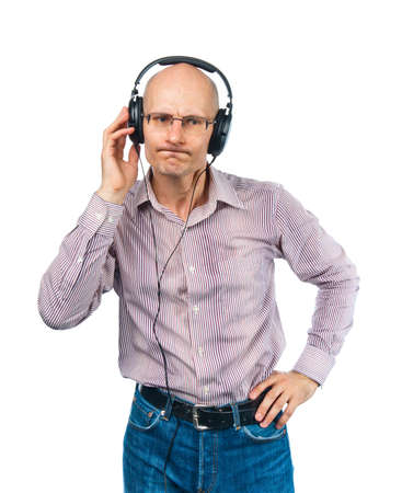 bespectacled man: Bespectacled man whith headphones listens music Stock Photo