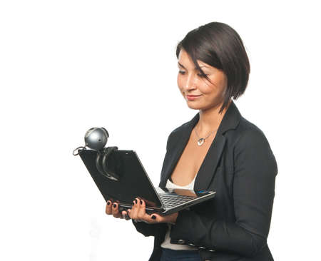 webcam: Young businesswoman with a laptop