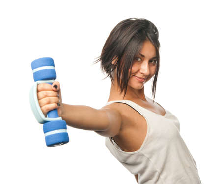 Sports girl doing exercises with dumbbells