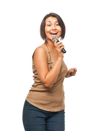 Pretty girl singing into a microphone photo