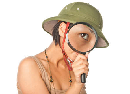 pith: Girl in a pith helmet looks throught magnifier Stock Photo