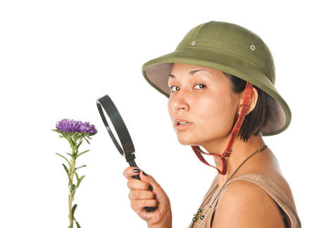 pith: Girl in a pith helmet explores flower