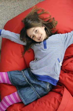 beanbag: Young girl lying on beanbag