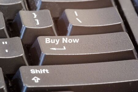 A computer keyboard button with a buy now button