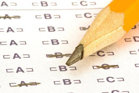 テストの泡シートの上に座って鉛筆 写真素材