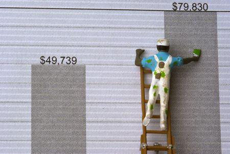 A painter showing money growth on a graph Banco de Imagens - 5821888