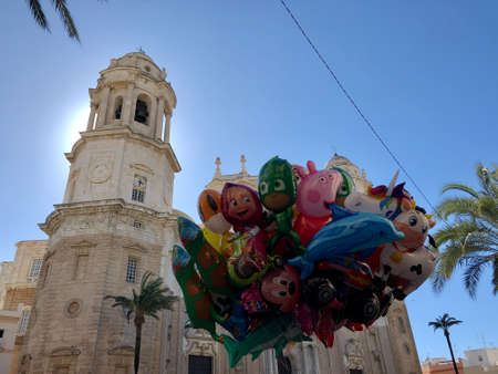 Bunch of balloons in front of cathedral of cadiz, south of Spain. Photo taken during carnivals fests.