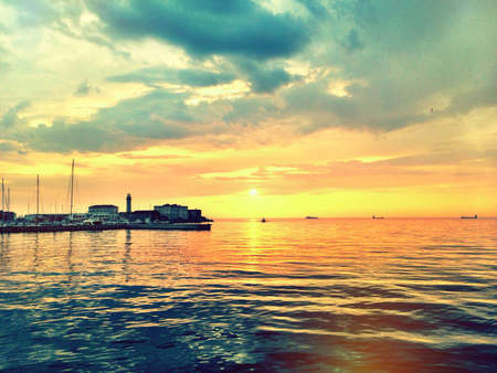california beach: Harbor sunset