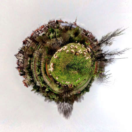dun: Abstract globe with farm and sheeps at sunset!
